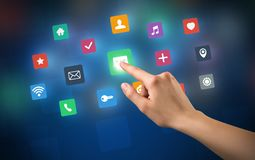 Hand touching apps. Female hand touching colorful applications Stock Photo