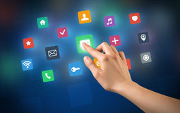 Hand touching apps Stock Photography