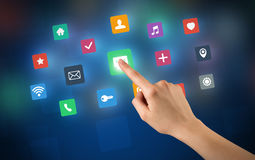 Hand touching apps. Female hand touching colorful applications Stock Photos