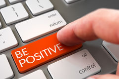 Hand Touching Be Positive Button. 3D. Royalty Free Stock Photography