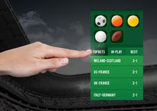 Hand touching a Betting App Interface stadium Royalty Free Stock Image