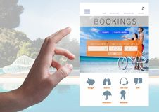 Hand Touching Bookings Holiday break App Interface with swimming pool Royalty Free Stock Photo