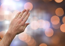 Hand touching brightness with sparkling light bokeh background. Digital composite of Hand touching brightness with sparkling light bokeh background Royalty Free Stock Photos