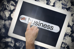 Hand touching business on search bar on tablet screen Stock Photography