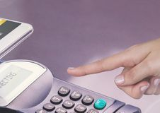 Hand touching card reader with purple background Royalty Free Stock Photos