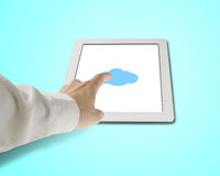 Hand touching cloud shape icon on tablet in green background Stock Photo