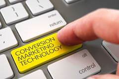 Hand Touching Conversion Marketing Technology Key. 3D. Mans Finger Pressing Yellow Conversion Marketing Technology Key on Computer Keyboard. 3D Illustration Stock Photography