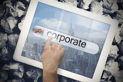 Hand touching corporate on search bar on tablet screen Royalty Free Stock Photography