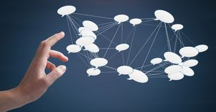 Hand touching 3D chat bubble connected icons. Digital composite of Hand touching 3D chat bubble connected icons Royalty Free Stock Photos
