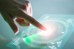 Hand touching data screen. Futuristic technology concept. Stock Photos