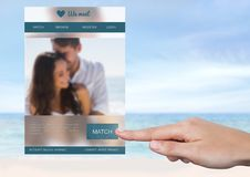 Hand touching a Dating App Interface Royalty Free Stock Image
