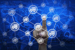Hand touching delivery truck icon with connection line over map Royalty Free Stock Photo