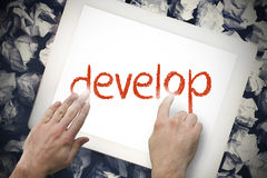 Hand touching develop on search bar on tablet screen Stock Photos
