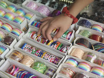 Hand Touching Different Bracelets On Display Stock Images