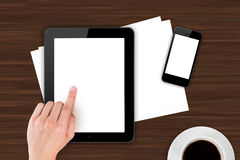 Hand Touching Digital Devices on Office Table Royalty Free Stock Image