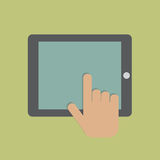Hand touching digital tablet.  Royalty Free Stock Photography