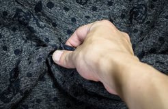 Hand touching fabric Stock Images
