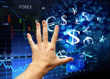 Hand touching forex interface Stock Photos