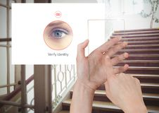 Hand Touching Glass Screen and Identity eye Verify App Interface on stairs Royalty Free Stock Photos