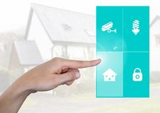 Hand touching a Home automation system App Interface. Digital composite of Hand touching a Home automation system App Interface Royalty Free Stock Image