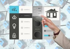 Hand touching a Home automation system App Interface Royalty Free Stock Image