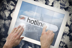 Hand touching hotline on search bar on tablet screen Royalty Free Stock Images