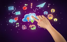 Hand touching icons. Female hand toucing mixed media icons with purple background Stock Image