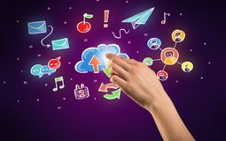 Hand touching icons. Female hand toucing mixed media icons with purple background Royalty Free Stock Photos
