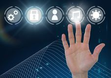 Hand touching icons interface of internet of things. Digital composite of Hand touching icons interface of internet of things Royalty Free Stock Photo