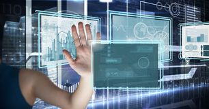 Hand touching and interacting with technology interface panels. Digital composite of Hand touching and interacting with technology interface panels Stock Image
