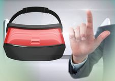 Hand touching and interacting with virtual reality headset with transition effect Royalty Free Stock Photo