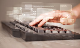 Hand touching keyboard with high tech buttons Stock Images