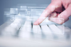 Hand touching keyboard with high tech buttons. Hand touching keyboard with high tech button screen Royalty Free Stock Photo