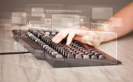 Hand touching keyboard with high tech buttons. Hand touching keyboard with high tech button screen Royalty Free Stock Photos