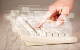 Hand touching keyboard with high tech buttons. Hand touching keyboard with high tech button screen Royalty Free Stock Image