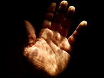 Hand Touching Light Stock Photography