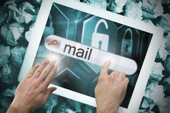 Hand touching mail on search bar on tablet screen Stock Photo