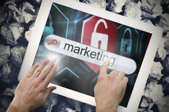 Hand touching marketing on search bar on tablet screen Royalty Free Stock Photography