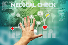 Hand touching medical interface Royalty Free Stock Images