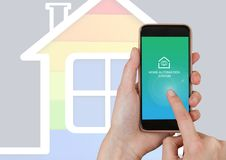 Hand touching mobile ohone with Home automation system App Interface Royalty Free Stock Photo
