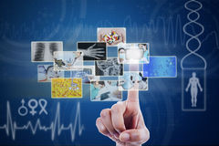 Hand touching pictures on virtual screen. Doctor touching pictures on blue virtual screen Royalty Free Stock Image