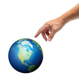 Hand touching planet Earth. Male hand reaching to touch planet Earth, isolated on white royalty free stock photography