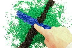 Hand touching polymer granules Royalty Free Stock Photos