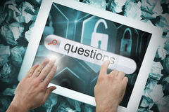 Hand touching questions on search bar on tablet screen Royalty Free Stock Images
