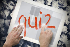Hand touching quiz on search bar on tablet screen Stock Photography