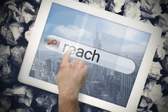 Hand touching reach on search bar on tablet screen Stock Photo
