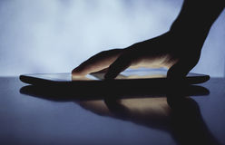 Hand with touching screen. Hand touching screen on modern digital tablet pc Royalty Free Stock Image