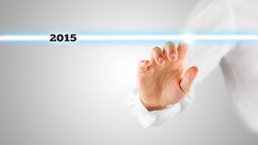 Hand Touching Screen with Highlighted 2015 Royalty Free Stock Photography
