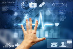 Hand touching screen with medical data. Hand touching interface with medical data Royalty Free Stock Images
