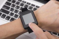 Hand touching screen smart watch technology gadget. Communication stock photography